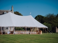 Marquee in high summer with Smedmore House behind