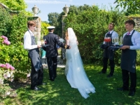 Bride and Groom entering garden