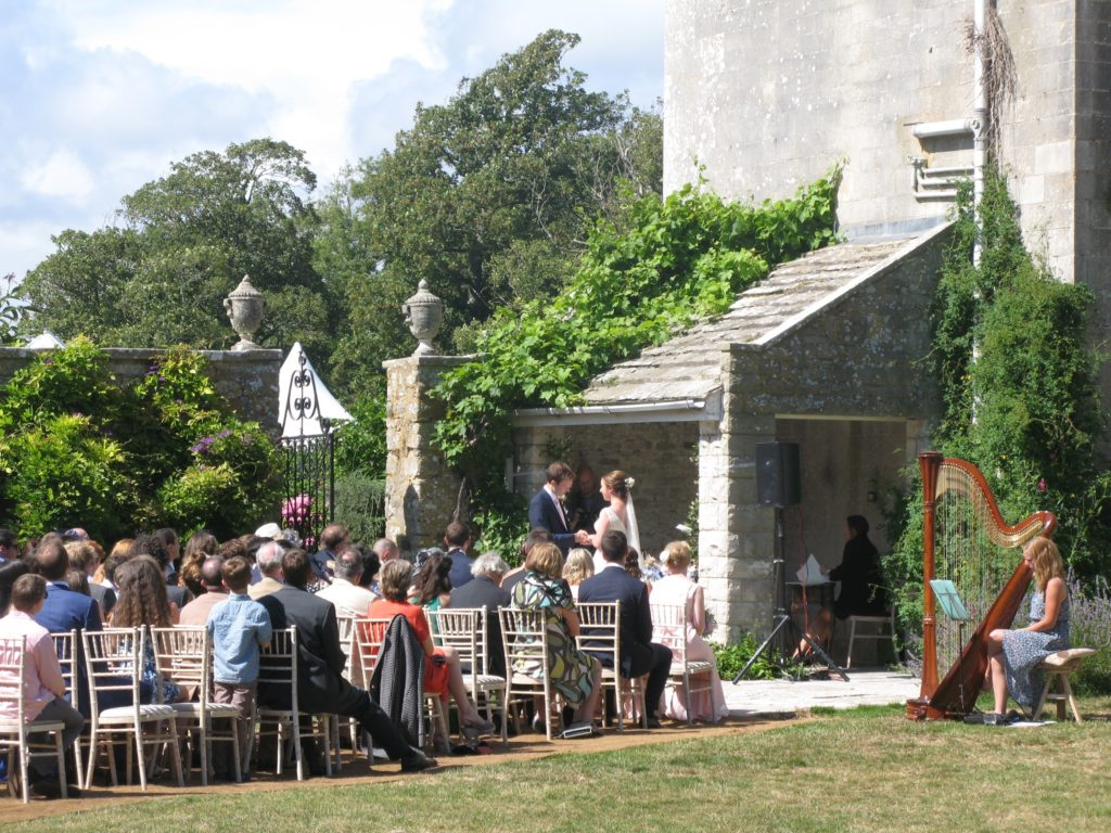 Smedmore House wedding and events venue in Dorset garden ceremony